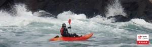 Outdoor activities including kayaks, coasteering, climbing in Pembrokeshire