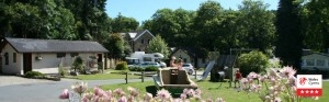 Mill House Caravan Park Play Area with old watermill in background
