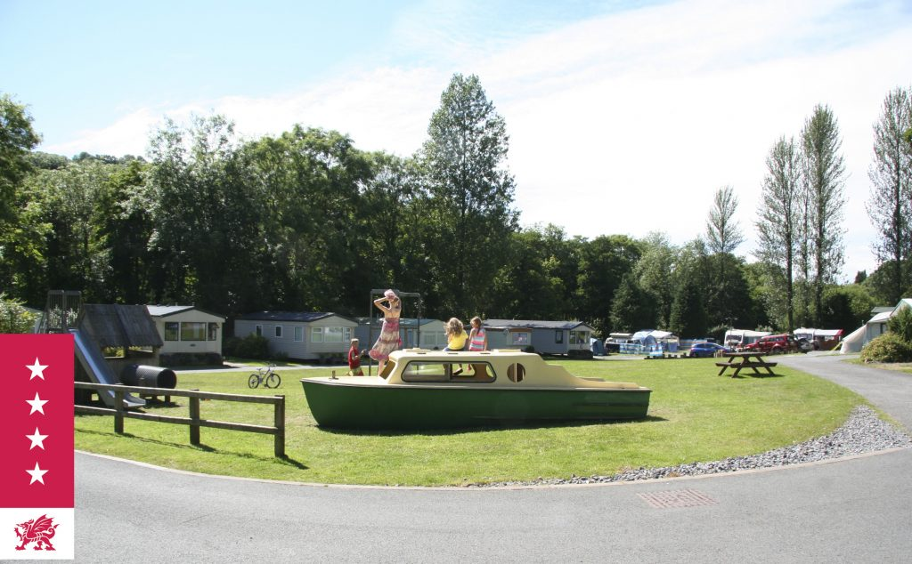 Touring Caravan Park with Tent Pitches and Static Caravan Holiday Homes situated around the central play area